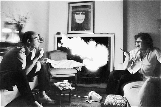 Hunter S. Thompson exhaling lighter fluid at Jann Wenner, at Wenner's New York home . Annie Liebovitz 1976, Contact Press Images