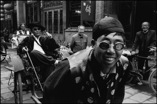 PINGYAO, China—A dressed-up pedicab driver, 2001. © Martine Franck / Magnum Photos