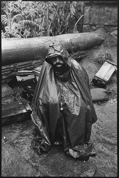 Director Francis Ford Coppola shelters himself from the driving rain that added to the troubles of an already beleaguered shoot for Apocalypse Now (1979). Mary Ellen Mark