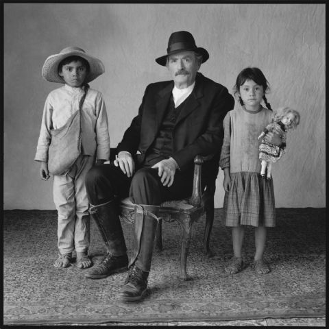 Gregory Peck with two young extras, Old Gringo, Mexico City, Mexico. Mary Ellen Mark, 1988