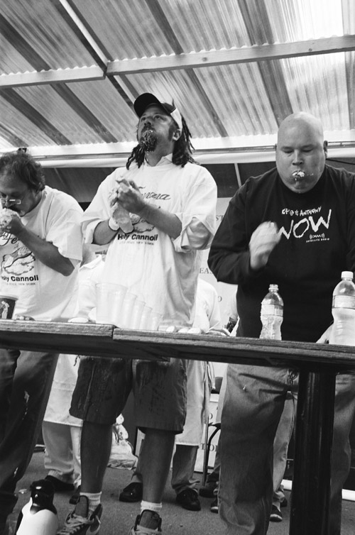 Cannoli Eating Competition, Annual Feast of San Gennaro, Little Italy; Leica M6 TTL 0.58, 35mm Summicron, Kodak Tri-x 400 © Doug Kim