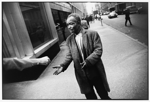 Street Beggar Reaching Out to Receive a Donation, Garry Winogrand, 1968 © The Estate of Garry Winogrand