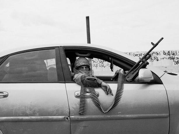 RAS LANUF, Libya—Rebels drive toward the front line after pro-Qaddafi forces retook Ras Lanuf, March 2011. © Alex Majoli / Magnum Photos