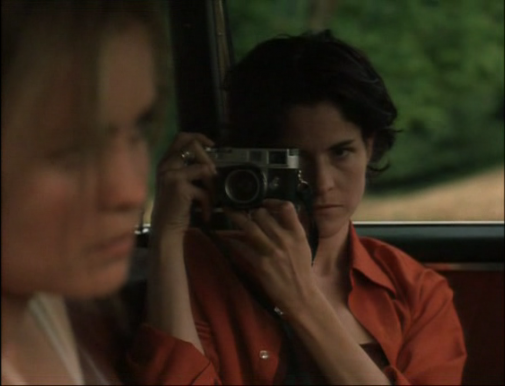 Ally Sheedy and a chrome M2 and what appears to be a 35mm Summicron in High Art, 1998 - she also has both ends of the strap attached to one side