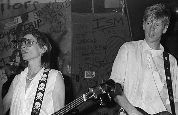 Kim Gordon & Thurston Moore, Sonic Youth at CBGB © Stephanie Chernikowski, 1983, Courtesy The Museum of Modern Art