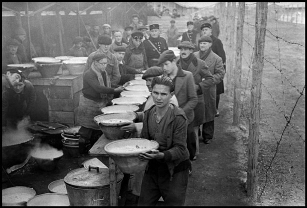 BRAM, France—A line of men receiving food in an internment camp for Republican exiles, March 1939. © ROBERT CAPA © 2001 By Cornell Capa / Magnum Photos