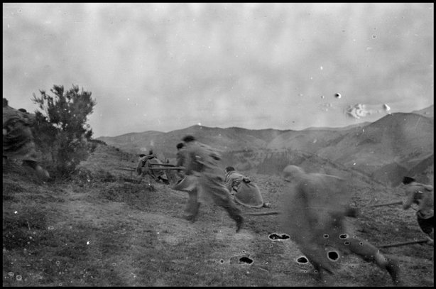 AMOREBIETA, Spain—Republican soldiers running in the Basque region, 1937. © David Seymour / Magnum Photos