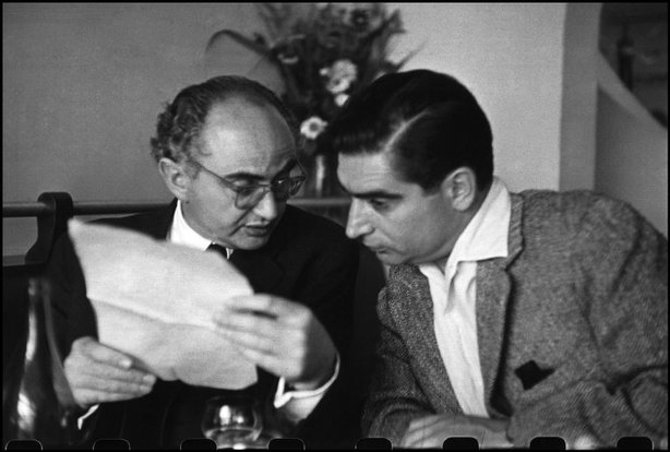 "PARIS—Photographers David Seymour, ""Chim,"" (left) and Robert Capa, 1952. © Henri Cartier-Bresson / Magnum Photos"