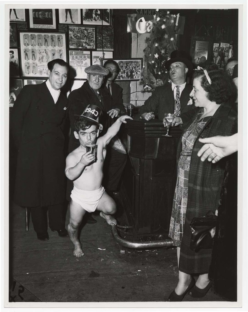 Shorty, the Bowery Cherub, New Year's Eve at Sammy's Bar, New York], 1943 © Weegee