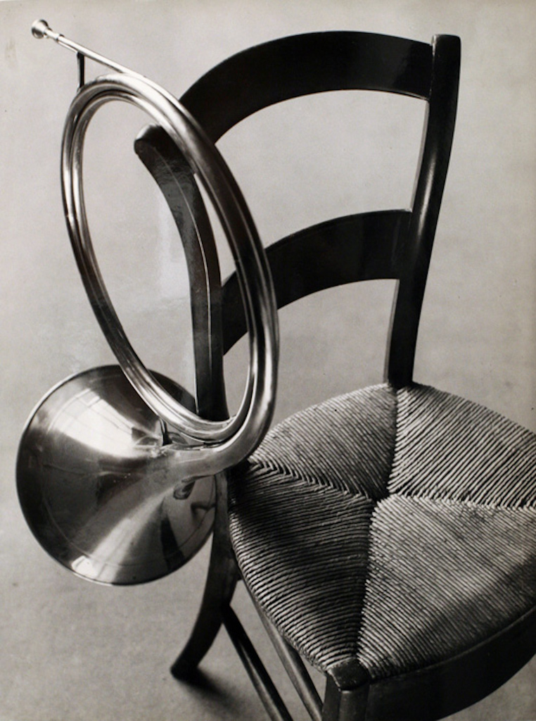 Chair with French Horn, 1927 © André Kertész