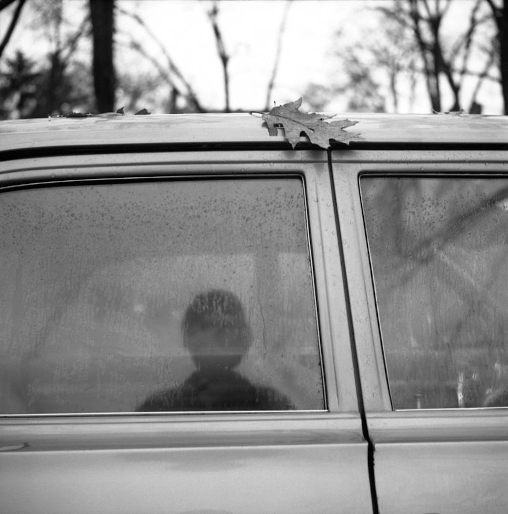 Self-Portrait (Car Window Reflection with Leaf), ca. 1967 © Vivian Maier
