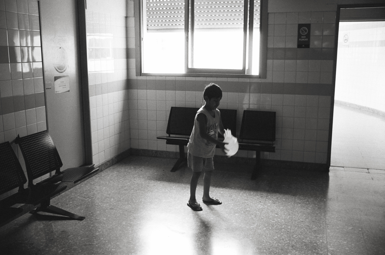 Buenos Aires, Argentina; Leica MP 0.72, 35mm Summilux, Kodak Tri-X © Doug Kim hospital kids playtime play rubber glove