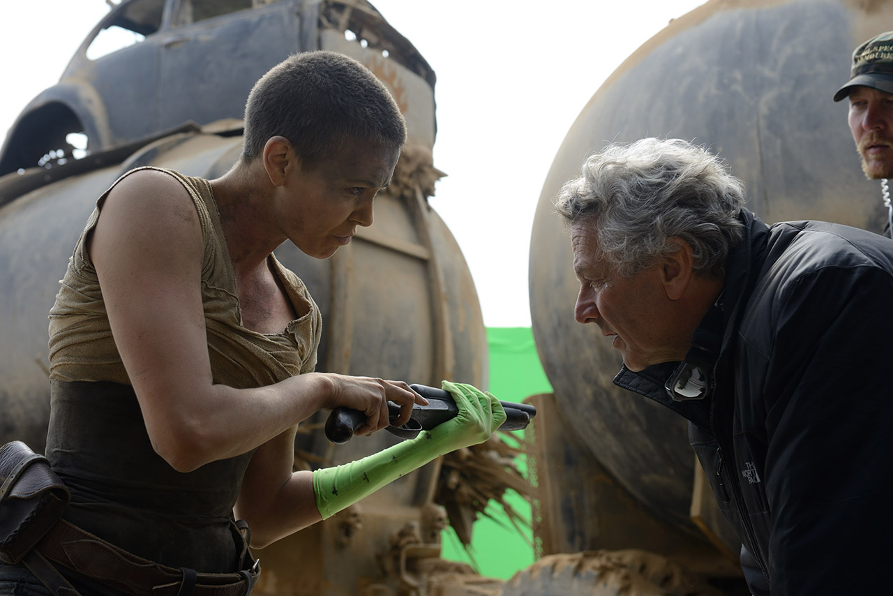 Charlize Theron and George Miller on the set of Mad Max: Fury Road (2015)